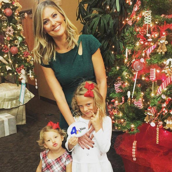 Mother Crystal Egger enjoying Christmas with her two daughters