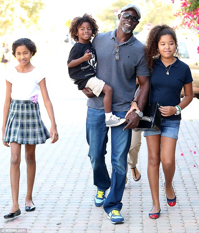 djimon hounsou ended things with wife but keeps in touch