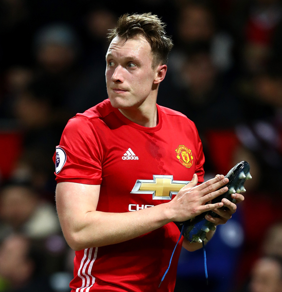 Phil Jones-The Man With Many Faces Celebrates Europa League After Successful Injury Comeback