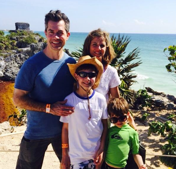 Natalie Morales with her husband and two kids during a vacation
